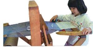 5 year old weaving on loom